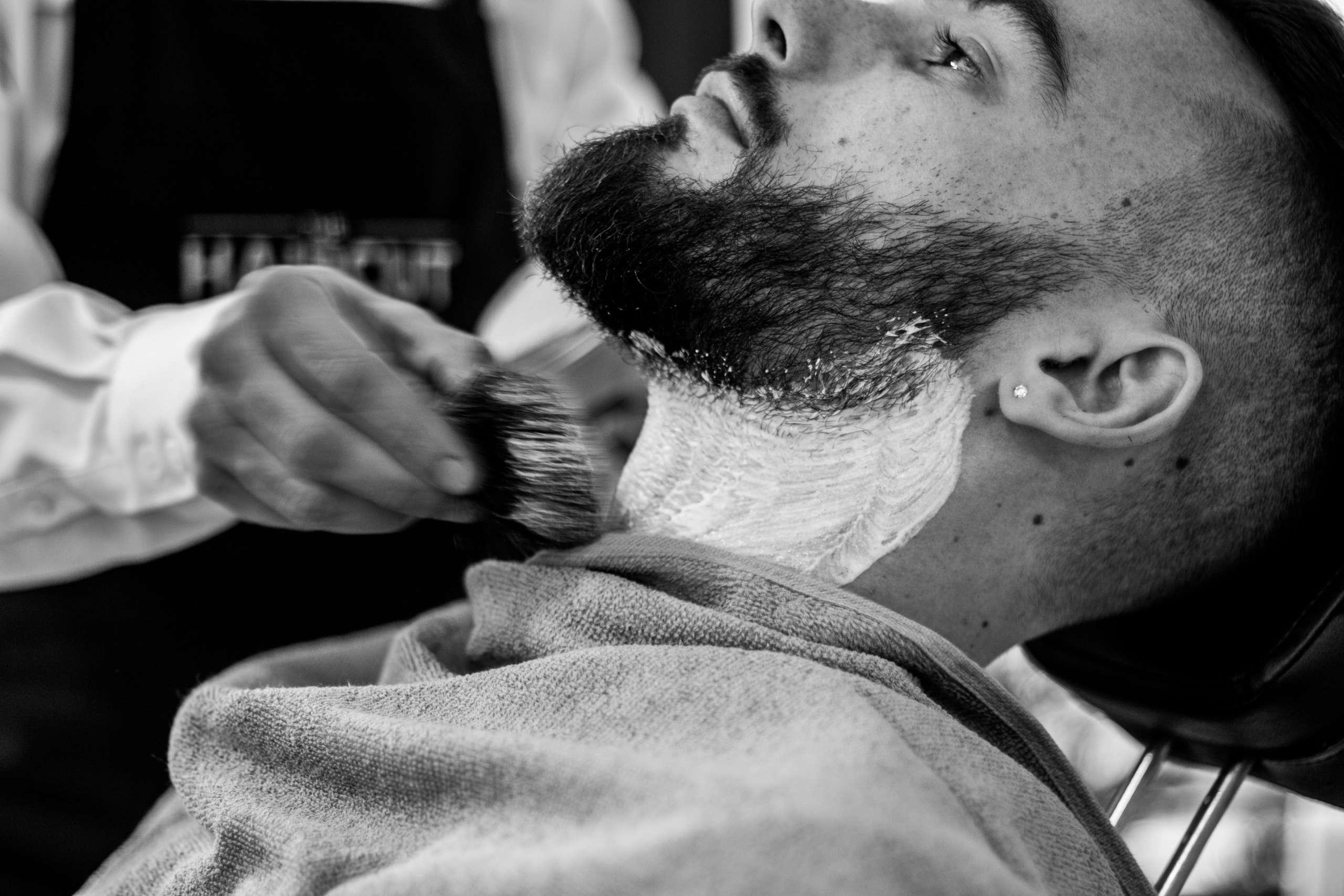 man shaving at barber